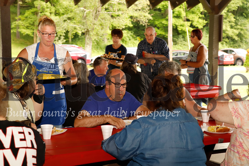 Rich-Mar Rotary volunteers serve up hot dogs at the rotary group's annual ARC Picnic at Butler Memorial Park Wednesday. The bbq and bingo night is for area residents with special needs. Seb Foltz/Butler Eagle
