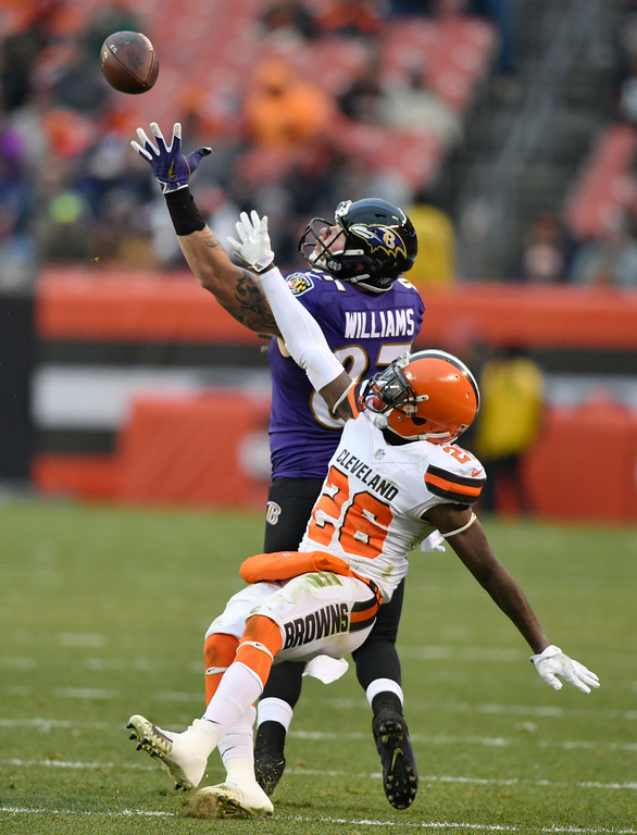 . Baltimore Ravens tight end Maxx Williams (87) can\'t hold onto the ball under pressure from Cleveland Browns strong safety Derrick Kindred (26) during the second half of an NFL football game, Sunday, Dec. 17, 2017, in Cleveland. (AP Photo/David Richard)