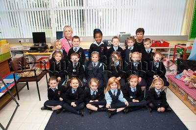 Teacher Miss Eimer Cranney,Classroom AssistantMiss Caroline Park and P1 pupils St Malachy's PS Carnagat Newry