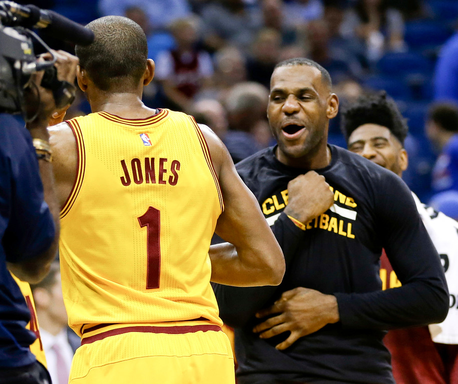 . Cleveland Cavaliers forward LeBron James, right, celebrates with guard James Jones (1) after Jones made several 3-point shots in a row against the Orlando Magic during the second half of an NBA basketball game, Friday, Dec. 11, 2015, in Orlando, Fla. Cleveland won 111-76.  (AP Photo/John Raoux)