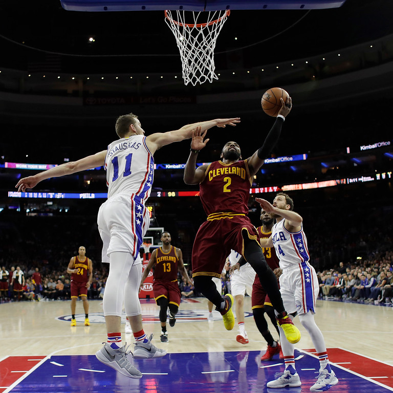. Cleveland Cavaliers\' Kyrie Irving (2) goes up for a shot against Philadelphia 76ers\' Nik Stauskas (11) during the second half of an NBA basketball game, Sunday, Nov. 27, 2016, in Philadelphia. Cleveland won112-108. (AP Photo/Matt Slocum)