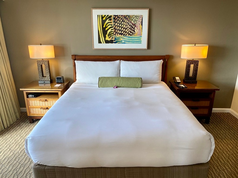Bed, nightstands and artwork in a Fairmont Kea Lani Oceanview Suite