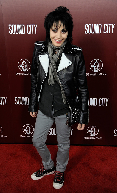""". Singer Joan Jett poses at the premiere of the documentary film \""""Sound City\""""  on Thursday, Jan. 31, 2013 in Los Angeles. (Photo by Chris Pizzello/Invision/AP Images)"""