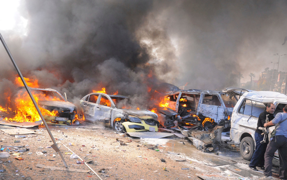 Description of . Vehicles burn after an explosion at central Damascus February 21, 2013, in this handout photograph released by Syria's national news agency SANA. The big explosion shook the central Damascus district of Mazraa on Thursday, residents said, and Syrian state media blamed what it said was a suicide bombing on