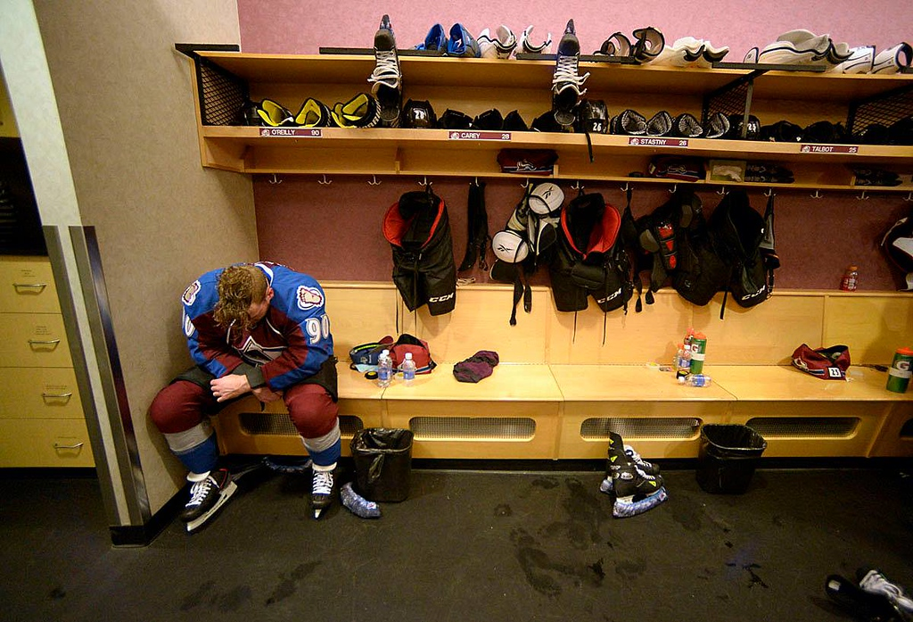 . Ryan O\'Reilly of the Colorado Avalanche sits dejected at his locker after their 4-5 overtime loss to the Minnesota Wild in game 7 of the Stanley Cup Finals at the Pepsi Center in Denver on Wednesday, April 30, 2014. (John Leyba/The Denver Post)