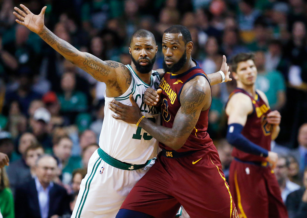 . Cleveland Cavaliers forward LeBron James, right, fights for position against Boston Celtics forward Marcus Morris (13) during the third quarter of Game 1 of the NBA basketball Eastern Conference Finals, Sunday, May 13, 2018, in Boston. (AP Photo/Michael Dwyer)