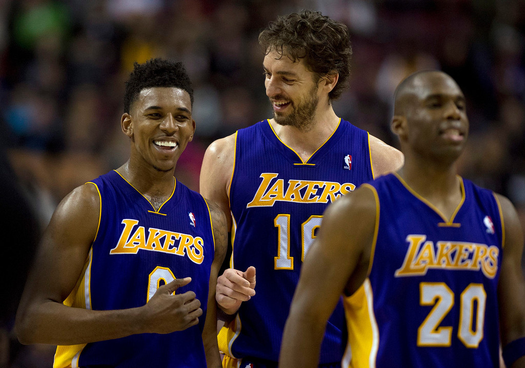 . Los Angeles Lakers center Pau Gasol (16) and guards Nick Young (0) and Jodei Meeks (20) walk off the court after defeating the Toronto Raptors 112-106 in NBA basketball game action in Toronto, Sunday, Jan. 19, 2014. (AP Photo/The Canadian Press, Frank Gunn)