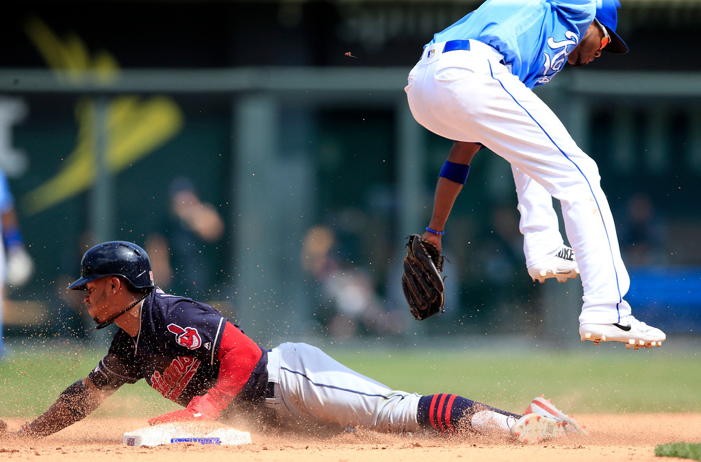 . Cleveland Indians\' Francisco Lindor (12) and Kansas City Royals shortstop Alcides Escobar (2) during a baseball game at Kauffman Stadium in Kansas City, Mo., Sunday, Aug. 20, 2017. (AP Photo/Orlin Wagner)