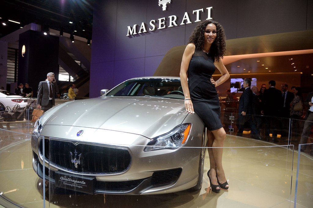 . A model stands beside the Maserati Quattroporte Ermenegildo Zegna at the IAA International Automobile Exhibition on September 10, 2013 in Frankfurt, Germany. The world\'s biggest motor show, the IAA, is running from September 12 to 22, 2013.   (Photo by Thomas Lohnes/Getty Images)