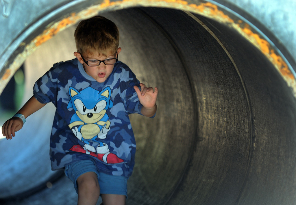 . A young boy runs through a tire tunnell.  Underwood Family Farms in Moorpark, CA hosted its Friends of the Farm weekend, launching its Fall Harvest Festival, which runs through Halloween.  The Saturday, September 28, 2013, event benefits the Ventura County Sheriff\'s & Fire Departments.  (Photo by Dean Musgrove/Los Angeles Daily News)