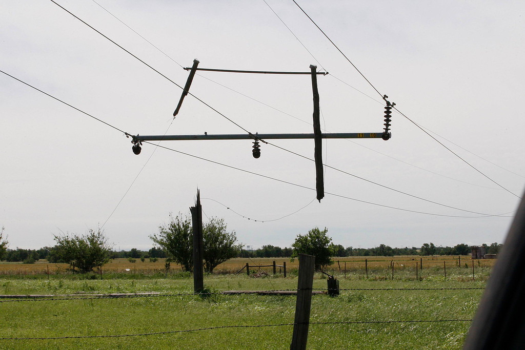 . Tornado-damaged power lines hang separated from its pole near El Reno, Oklahoma June 1, 2013. Nine people were killed in tornadoes that swept through central Oklahoma on Friday, part of a storm system that caused widespread flooding in Oklahoma City and its suburbs, the state\'s chief medical examiner said on Saturday. REUTERS/Bill Waugh