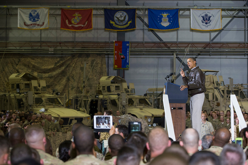 . President Barack Obama gestures as he speaks to troops at Bagram Air Field north of Kabul, Afghanistan during an unannounced visit, on Sunday, May 25, 2014. (AP Photo/ Evan Vucci)