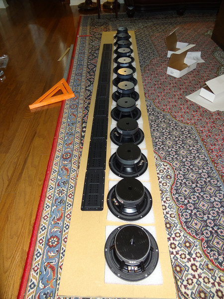"""The DR912a Line Array speaker baffle, with drivers positioned on it to mark the positions for their cutouts. Each tower is 92"""" tall by 14"""" wide, the minimum height needed to accommodate 12 Dayton Reference 7"""" woofers and 9 BG Neo 8 PDR planar tweeters. The tweeter array may appear short in comparison to the woofer array, but the top of each tweeter array will be almost 7' high."""