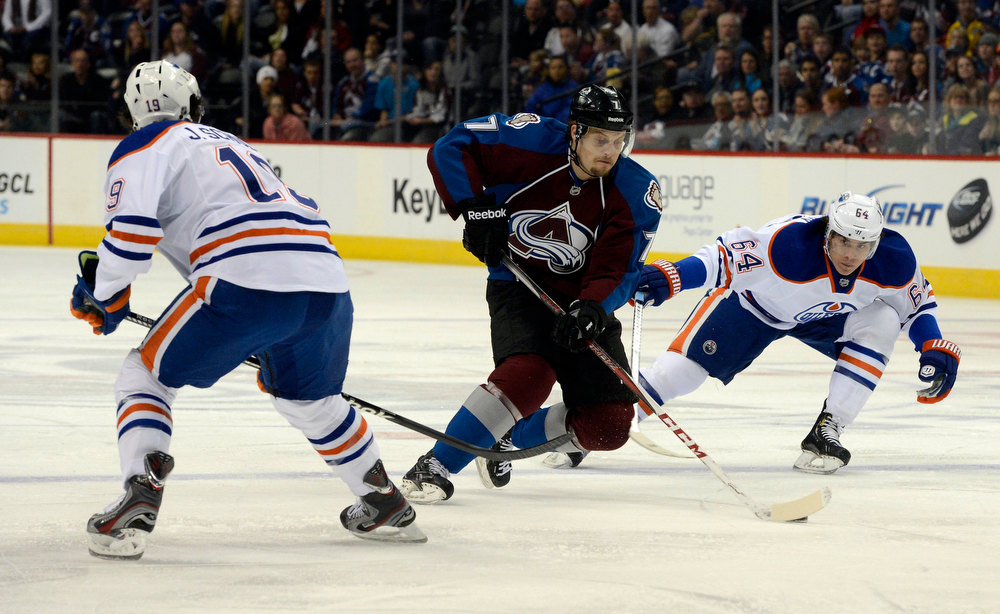 . DENVER, CO. - FEBRUARY 2ND: John Mitchell, Colorado Avalanche, center, advances the puck against the defense of Justin Schultz, left, and Nail Yakupov, Edmonton Oilers in the first period of play at the Pepsi Center in Denver Colorado, February 2nd, 2013.  (Photo By Andy Cross / The Denver Post)
