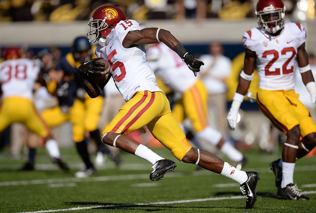 . USC 62, CALIFORNIA 28<br /> Nov. 9, 2013; California Memorial Stadium, Berkeley, Calif. The Trojans returned an NCAA record-tying three punts for touchdowns -- two by Nelson Agholor -- and Javorius Allen scored three times for the second straight game. Josh Shaw added a blocked punt returned for a touchdown. After Cal (1-9, 0-7) closed within 21-14 early in the second quarter, the Trojans outscored the Bears 41-14 the rest of the way. It was the third straight win for USC (7-3, 4-2) and fourth in its past five games.  (Photo by Thearon W. Henderson/Getty Images)