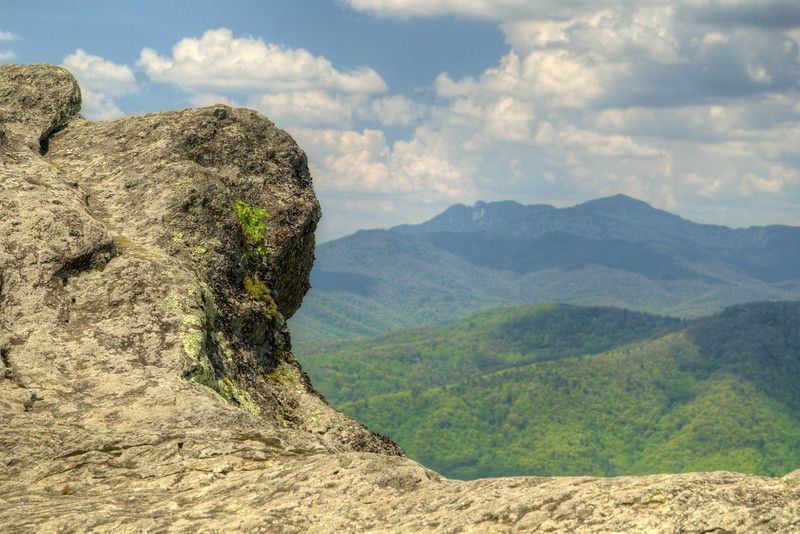 The infamous rock framing the distant Grandfather Mountain at The Blowing Rock in Blowing Rock, NC on Wednesday, May 6, 2015. Copyright 2015 Jason Barnette  The Blowing Rock is an attraction situated on the site of the namesake for the town. Visitors can view and even climb the rock while reading about the local legend of a love story that ended with a Cherokee brave jumping from the overhanging rock, only to be thrust back on top by an upward blowing wind.
