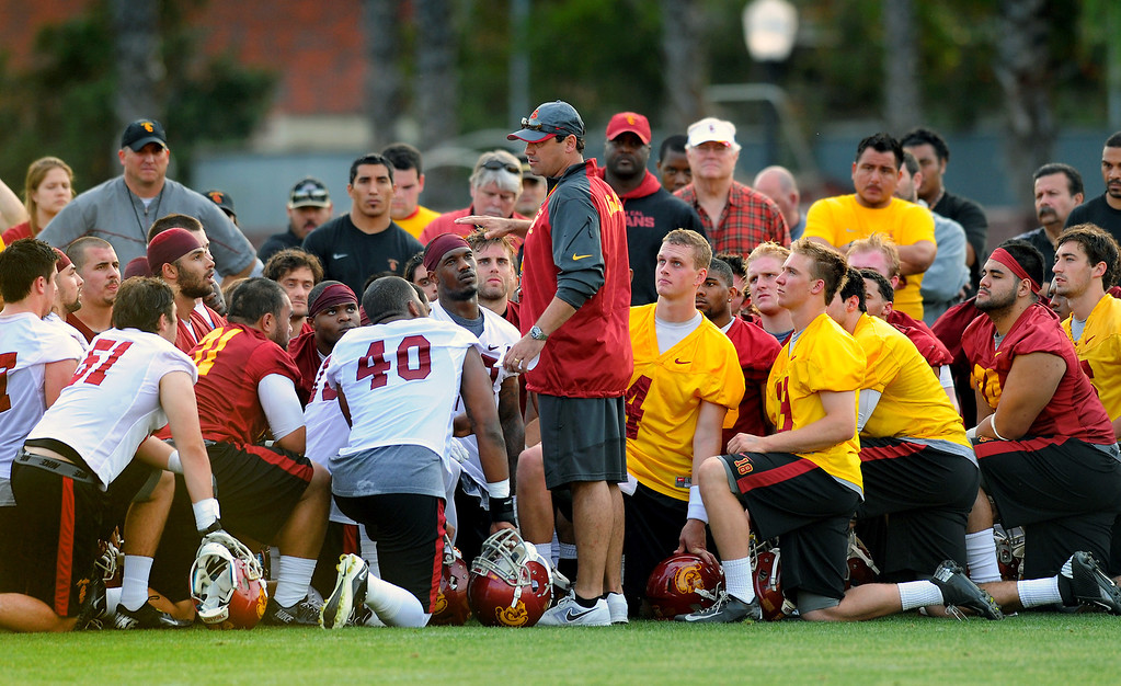 . USC head coach Steve Sarkisian talks to his team at the end of their first spring practice, Tuesday, March 11, 2014, at USC. (Photo by Michael Owen Baker/L.A. Daily News)