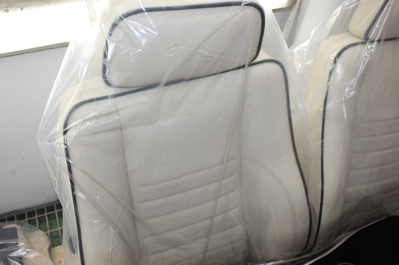 Cream leather with Jaguar Leaper embossed, perforated centre section and black piping