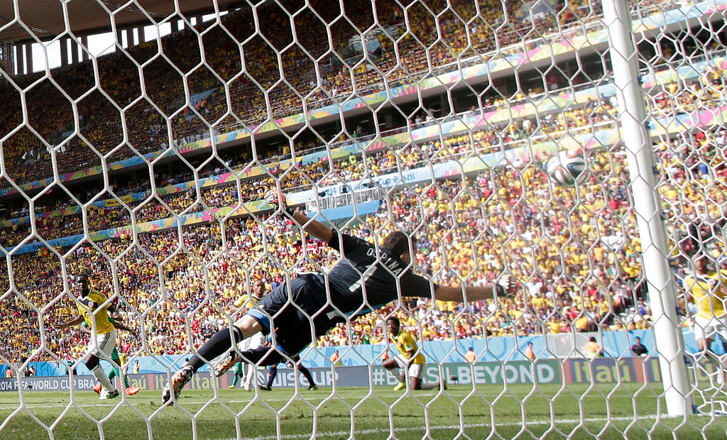 . Colombia\'s goalkeeper David Ospina fails to make a save as Ivory Coast\'s Gervinho scores his side\'s first goal during the group C World Cup soccer match between Colombia and Ivory Coast at the Estadio Nacional in Brasilia, Brazil, Thursday, June 19, 2014.  (AP Photo/Marcio Jose Sanchez)