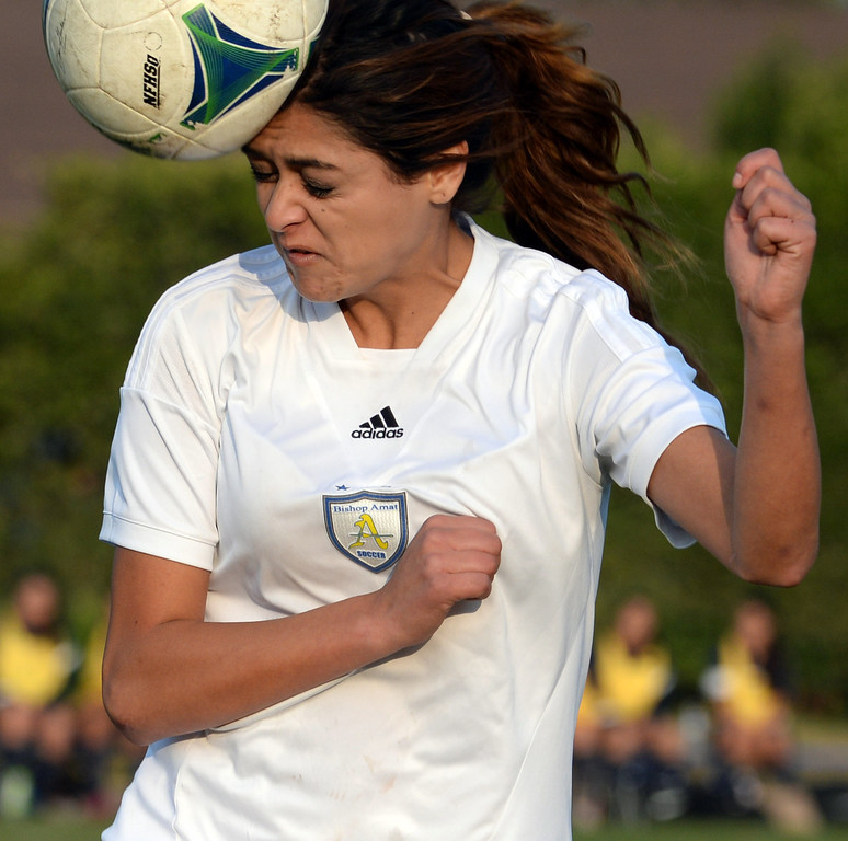 . Bishop Amat\'s Nicolette Martinez goes-up for the header against Marshall in the first half of a prep soccer match at Bishop Amat High School in La Puente, Calif., on Thursday, Jan. 9, 2014. (Keith Birmingham Pasadena Star-News)