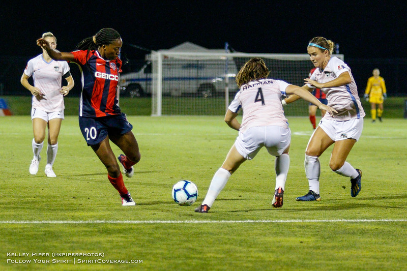 Washington Spirit forward Cheyna Matthews (20) takes a shot while Houston Dash defender Allysha Chapman (4) and Houston Dash midfielder Christine Nairn (10) try to defend at Maureen Hendricks Field in Boyds, MD, on July 20, 2019.