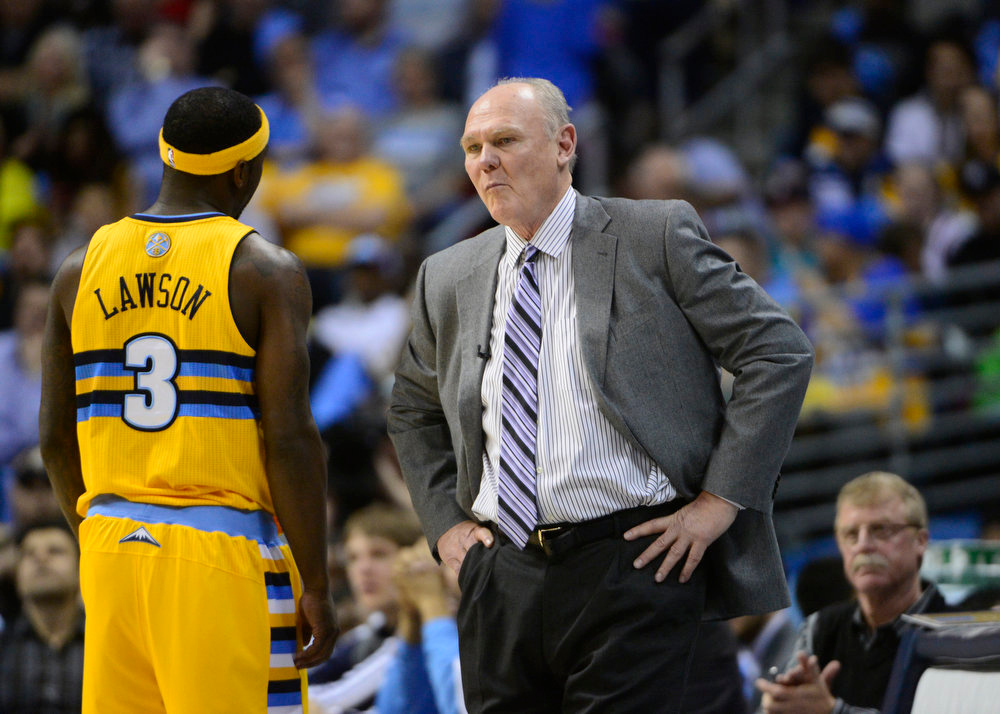 . Denver Nuggets head coach George Karl talks with Denver Nuggets point guard Ty Lawson (3) in the second quarter. The Denver Nuggets took on the Golden State Warriors in Game 2 of the Western Conference First Round Series at the Pepsi Center in Denver, Colo. on April 23, 2013. (Photo by AAron Ontiveroz/The Denver Post)