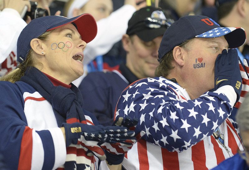 . US fans support their team during the Women\'s Ice Hockey Semifinals USA vs Sweden at the Shayba Arena during the Sochi Winter Olympics on February 17, 2014.    AFP PHOTO / ALEXANDER NEMENOVALEXANDER NEMENOV/AFP/Getty Images