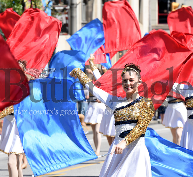 Harold Aughton/Butler Eagle: Maggie Sarvey of the Butler High School Marching Band waves her flag during the Memorial Day Parade, Monday, May 27.