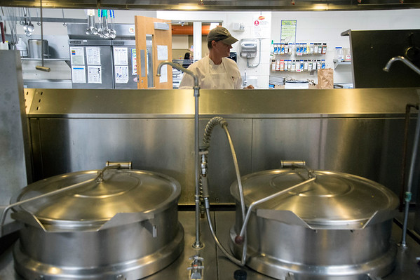 01/30/20 Wesley Bunnell | StaffrrThe annual SOUPerBowl to benefit the Friendship Centers Soup Kitchen took place on Thursday Jan 30, 2020 at E.C. Goodwin Technical School. A chef from the Friendship Center stands on the opposite side of large industrial kitchen containers.