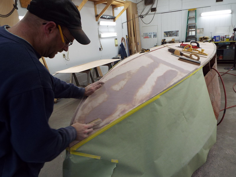 Fairing the bottom skin before the second layer is applied.