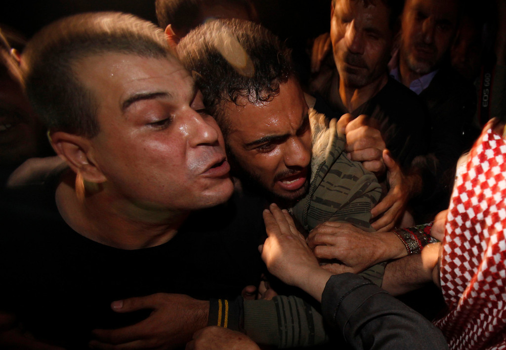 . A released Palestinian prisoner, Omar Masoud, 40, left, who was arrested in May 1993 for killing an Israeli lawyer, greets his mother Tamam Masoud, 70, right, upon his arrival to his family house in Shati Refugee Camp, Wednesday, Oct. 30, 2013. Israel freed 26 Palestinian prisoners early Wednesday, the second of four batches to be released as part of a deal that set in motion the current Israeli-Palestinian peace talks. (AP Photo/Adel Hana)