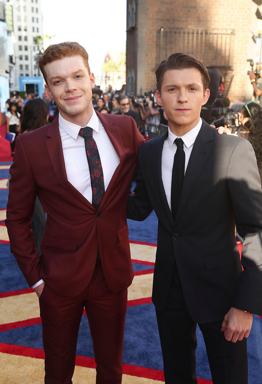 """. Cameron Monaghan, left, and Tom Holland seen at Columbia Pictures World Premiere of \""""Spider-Man: Homecoming\"""" at TCL Chinese Theatre on Wednesday, June 28, 2017, in Hollywood, CA. (Photo by Steve Cohn/Invision for Sony Pictures/AP Images)"""
