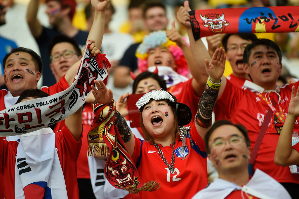 . South Korea\'s supporters cheer prior to a Group H football match between South Korea and Belgium at the Corinthians Arena in Sao Paulo during the 2014 FIFA World Cup on June 26, 2014. ODD ANDERSEN/AFP/Getty Images