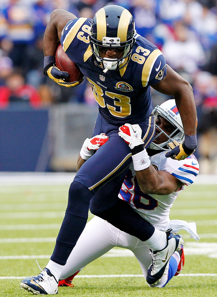 . St. Louis Rams wide receiver Brian Quick (83) is tackled by Buffalo Bills defensive back Justin Rogers (26) during the second half of an NFL football game, Sunday, Dec. 9, 2012, in Orchard Park, N.Y. (AP Photo/Bill Wippert)