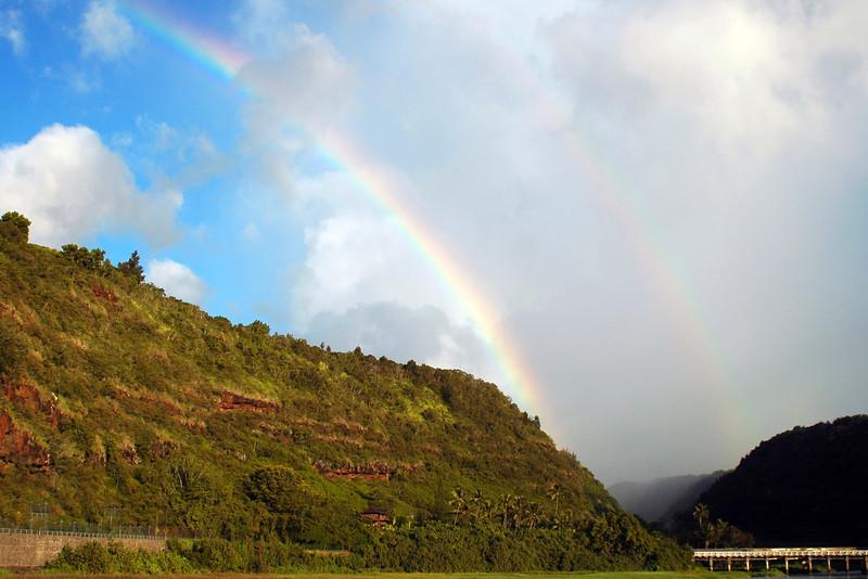 Rainbow over Waimea Bay, bridge on the Kamehameha Hwy on the North Shore of O'ahu, Hawai'i