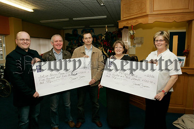 Donal Doran and John Fleming present cheqyes to Autism Newry and Mourne and Ms Therapy centre for £502.50 respectivly. The money was the proceeds of a recent Charity Night held in The Shamrocks GAA hall on the 4th Nov. Pictured recieving the cheques are, John Rice Treasurer PAPA along with Shiela Carragher and Theresa Cole from the MS Therapy centre. The organiser would wish to thank all who attended on the night for their generous donations. 06W48N3