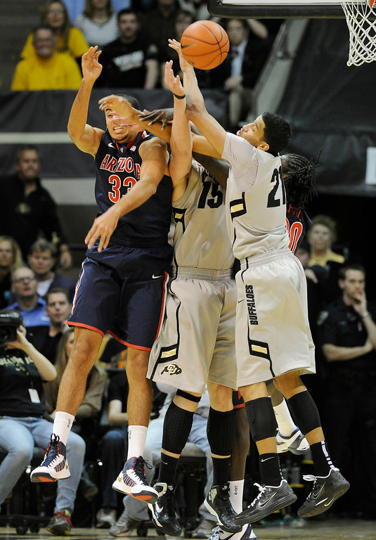 . BOULDER, CO. - FEBRUARY 14: Colorado\'s Shane Harris-Tunks (15) and Andre Roberson (21) battle for a rebound with Wildcats forward Grant Jerrett (33) in the first half. The University of Colorado men\'s basketball team hosted Arizona Thursday night, February 14, 2013 at the Coors Event Center in Boulder. (Photo By Karl Gehring/The Denver Post)