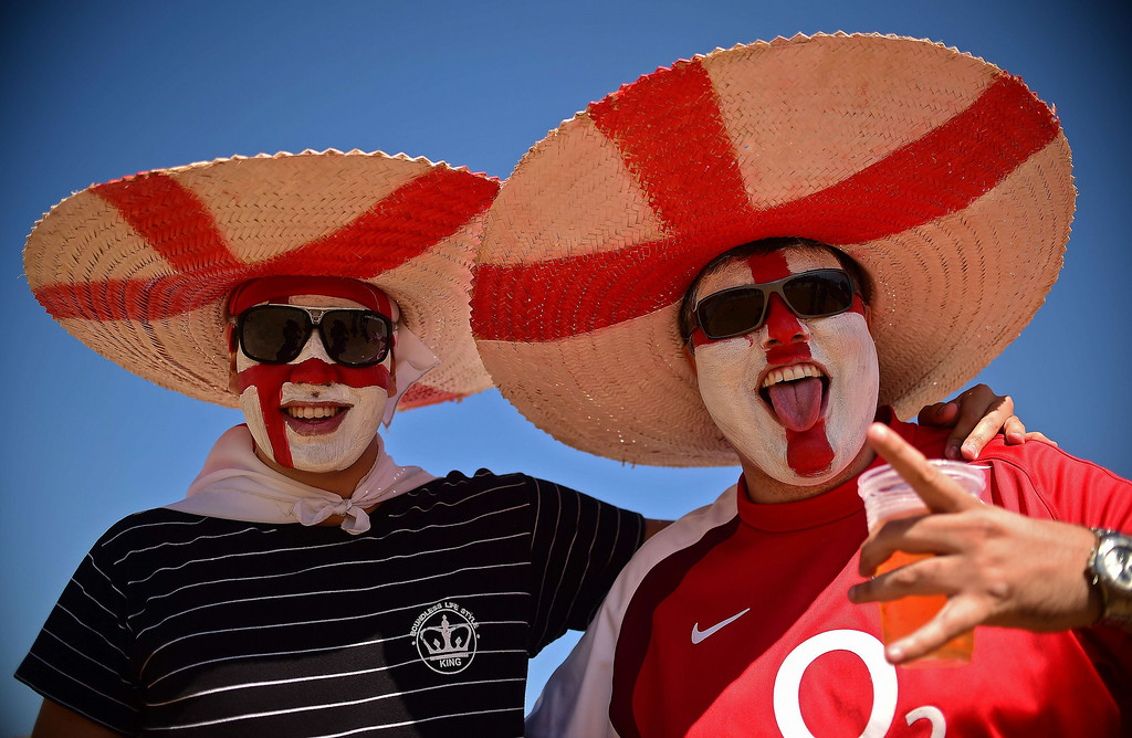 . England\'s fans pose upon their arrival at the Mineirao Stadium in Belo Horizonte on June 24, 2014 before the Group D football match between Costa Rica and England during the 2014 FIFA World Cup on June 24, 2014.  RONALDO SCHEMIDT/AFP/Getty Images