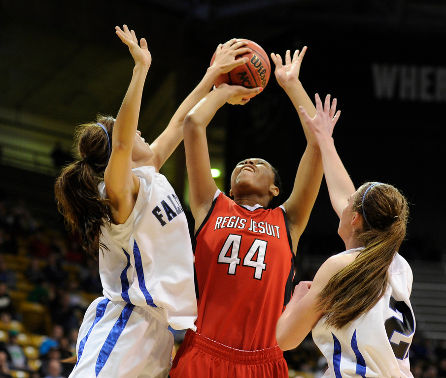 . BOULDER, CO. - MARCH 16: Regis center Jordan Molyneaux (44) has a shot blocked in the second half. The Regis Jesuit High School girl\'s basketball team defeated Highlands Ranch 53-46 in the 5A championship game Saturday, March 16, 2013 at the Coors Events Center in Boulder.  (Photo By Karl Gehring/The Denver Post)