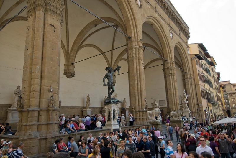 Tourists at Loggia dei Lanzi in Florence, Italy