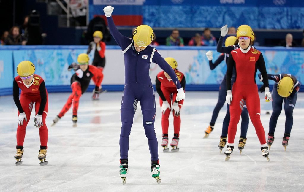 . Shim Suk-Hee of South Korea, center celebrates her team\'s first place in the women\'s 3000m short track speedskating relay final at the Iceberg Skating Palace during the 2014 Winter Olympics, Tuesday, Feb. 18, 2014, in Sochi, Russia. (AP Photo/David J. Phillip )