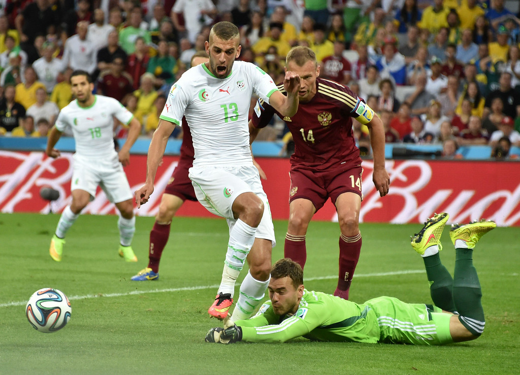 . Russia\'s goalkeeper Igor Akinfeev (bottom R) defends his goal against the attack of Algeria\'s forward Islam Slimani (C) during a Group H football match between Algeria and Russia at the Baixada Arena in Curitiba during the 2014 FIFA World Cup on June 26, 2014. KIRILL KUDRYAVTSEV/AFP/Getty Images