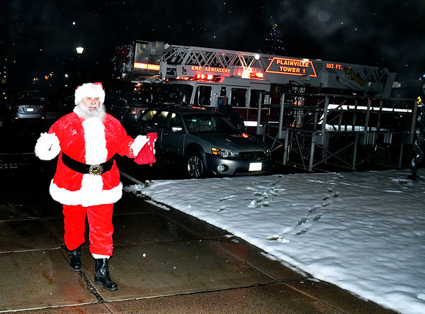 12/13/2019 Mike Orazzi | Staff Santa arrives at the Plainville Fire Company for the town tree lighting ceremony on Friday evening.
