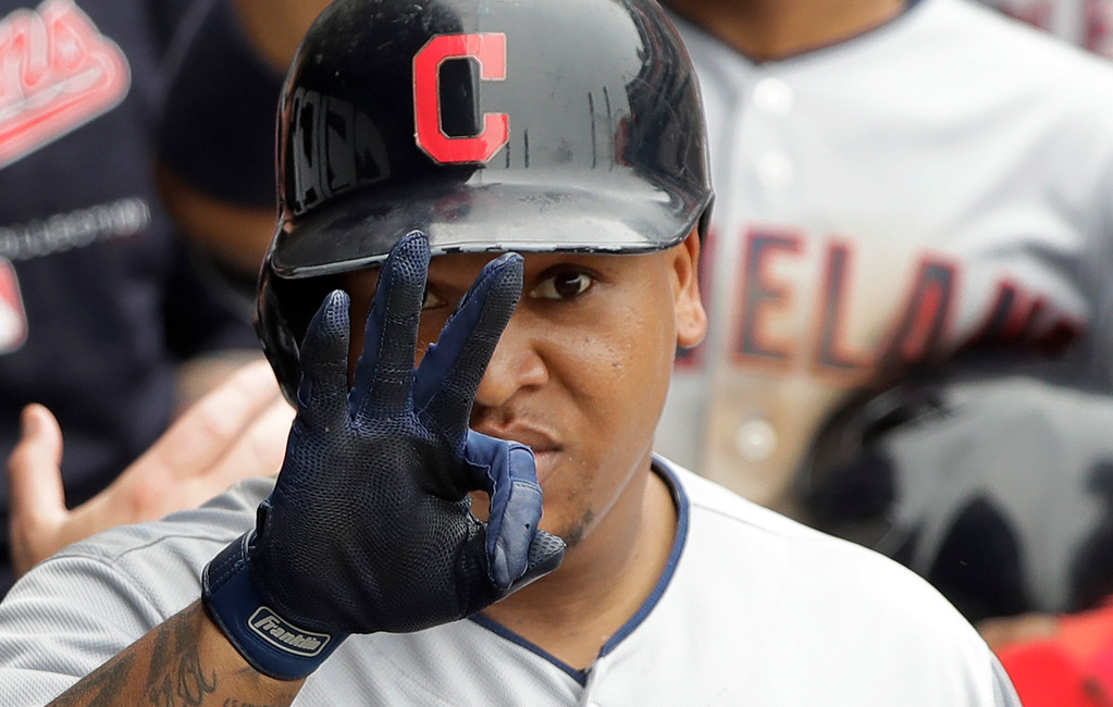 . Cleveland Indians\' Jose Ramirez gestures as he signals his mother while celebrating in the dugout after hitting a two-run home run off Chicago White Sox\'s Chris Volstad during the seventh inning of a baseball game Thursday, June 14, 2018, in Chicago.. (AP Photo/Charles Rex Arbogast)