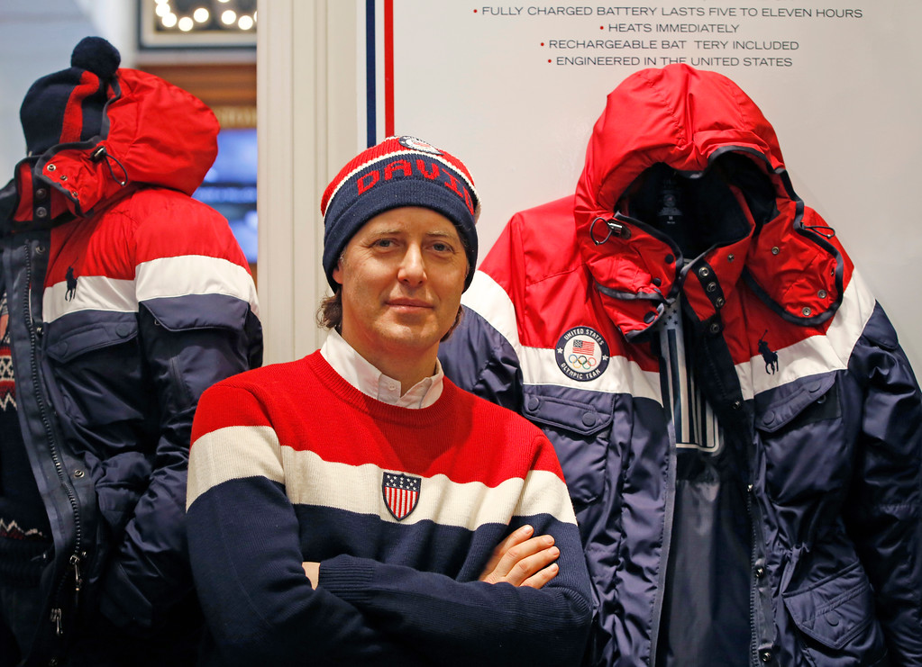 . David Lauren poses beside Team USA\'s Opening Ceremony parka, which features a battery-powered heating element inside to keep athletes warm during the Winter Olympics in Pyeongchang, South Korea, Monday, Jan. 22, 2018, in New York. (AP Photo/Kathy Willens)