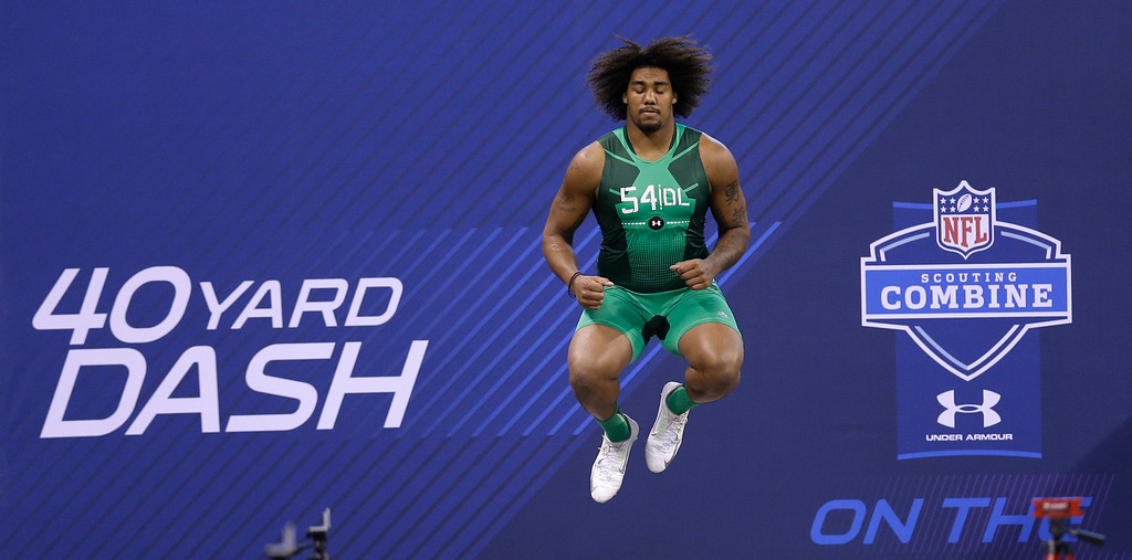 . USC defensive lineman Leonard Williams jumps before running the 40-yard dash at the NFL football scouting combine in Indianapolis, Sunday, Feb. 22, 2015. (AP Photo/David J. Phillip)