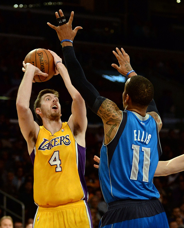 . Los Angeles Lakers forward Ryan Kelly (4) shoots over Dallas Mavericks guard Monta Ellis (11) in the first quarter during an NBA basketball game in Los Angeles, Calif., on Friday, April 4, 2014.  (Keith Birmingham Pasadena Star-News)