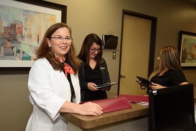Dr Fleischi Talking with Staff