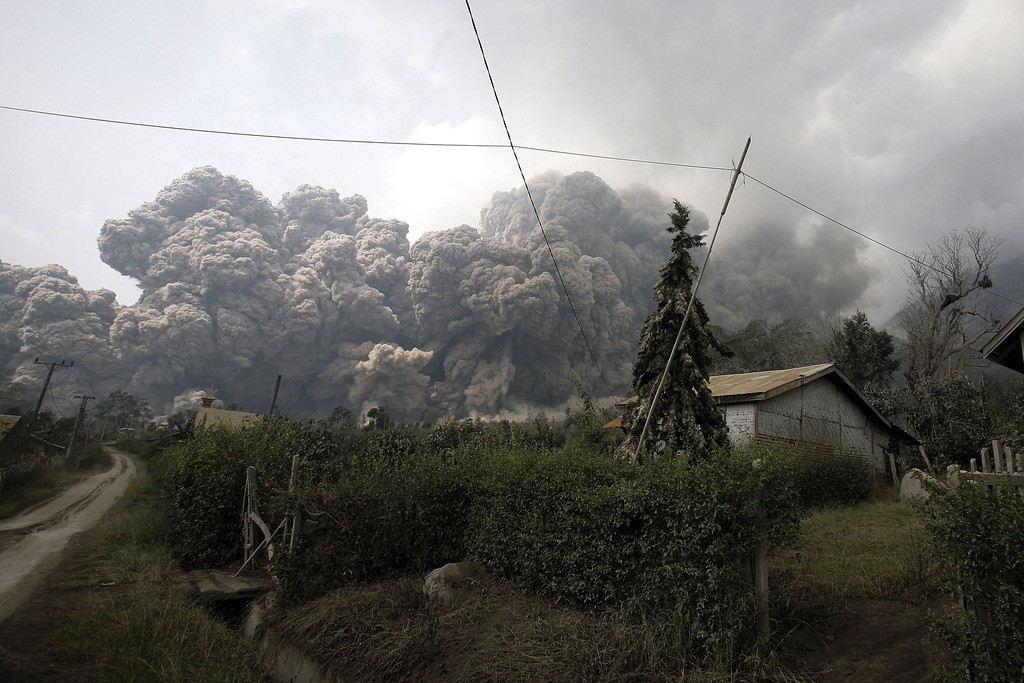 . A giant cloud of hot volcanic ash clouds engulfs villages in Karo district during the eruption of Mount Sinabung volcano located in Indonesia\'s Sumatra island on February 1, 2014.   AFP PHOTO / CHAIDEER  MAHYUDDIN/AFP/Getty Images