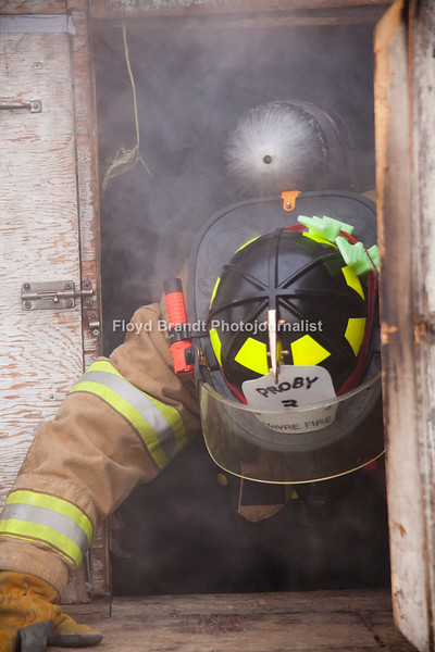 "Havre Daily News/Floyd Brandt  Smoke poured out of a trailer parked at the Havre Fire Department where Firefighter Austin Shupe exits the Confined Space Training trailer Monday . The traing helps the firefighters prepare themselves for entering a fire that may be very confining and dangerous. Assisant Fire Chief Kelly Jones said that it gives his firefighters a chance to get use to their equipment and gear in small spaces and to look out for hazards. For Chris Cox, ""It was tight and you can't see anything but it was a lot of fun,"" he said."
